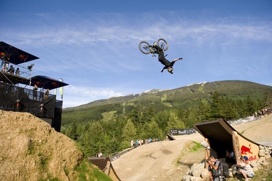 Rogue Mag Mountain Biking Red Bull Kurt Sorge performs a tuck no handed flip at Joyride